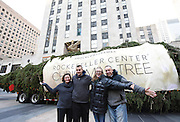 Angie, Brock, Ava and Graig Eichler, left to right, of Oneonta, NY, pose with the 94-foot-tall Norway Spruce from their backyard that will become the Rockefeller Center Christmas Tree in Rockefeller Plaza, Saturday, Nov. 12, 2016, in New York. The 84th Rockefeller Center Christmas Tree Lighting ceremony will take place on Wednesday, Nov. 30. (Photo by Diane Bondareff/AP Images for Tishman Speyer)