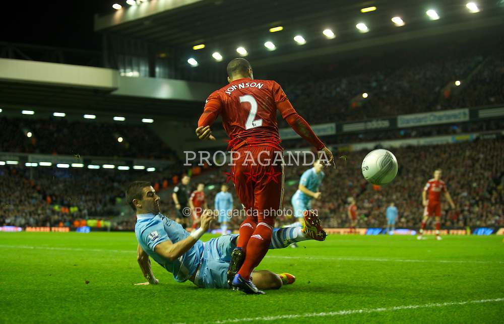 LIVERPOOL, ENGLAND - Wednesday, January 25, 2012: Liverpool's Glen Johnson in action against Manchester City's Aleksandar Kolarov during the Football League Cup Semi-Final 2nd Leg at Anfield. (Pic by David Rawcliffe/Propaganda)