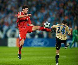 MARSEILLE, FRANCE - Tuesday, September 16, 2008: Liverpool's Albert Riera and Olympique de Marseille's Laurent Bonnart during the opening UEFA Champions League Group D match at the Stade Velodrome. (Photo by David Rawcliffe/Propaganda)