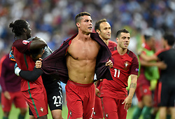 An emotional and topless Cristiano Ronaldo of Portugal moves towards the Portugal fans to celebrate Winning the Uefa European Championship after the game  - Mandatory by-line: Joe Meredith/JMP - 10/07/2016 - FOOTBALL - Stade de France - Saint-Denis, France - Portugal v France - UEFA European Championship Final