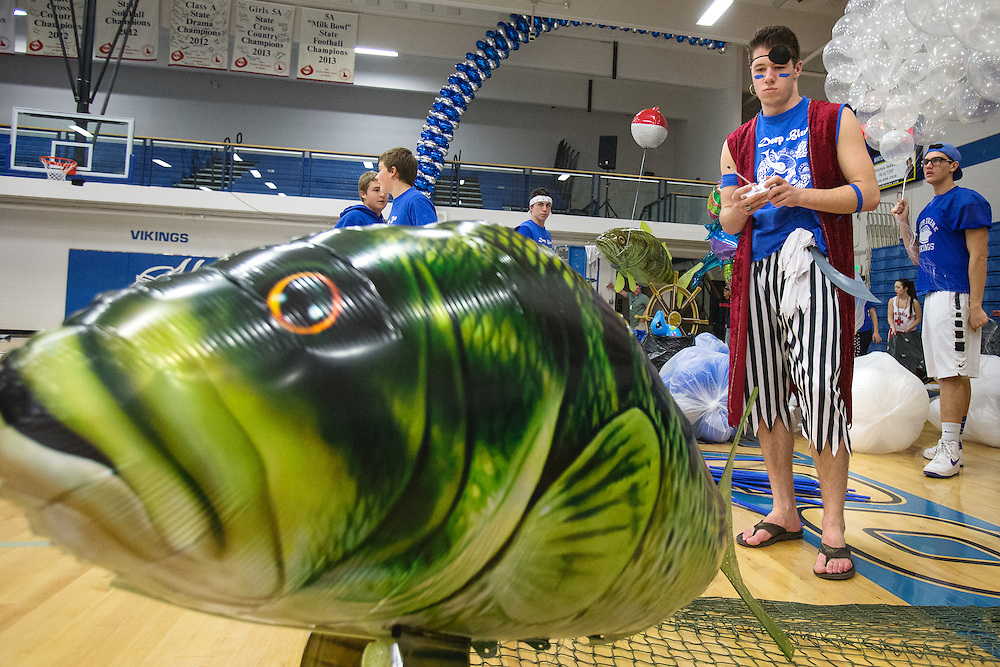 GABE GREEN/Press<br /> <br /> John Williams, a Coeur d&rsquo;Alene High School senior pilots a remote control, flying fish Friday as students decorate the school gym for Fight for The Fish.