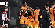 Chuba Akpom and Moses Odubajo start the celebrations after the Sky Bet Championship match between Brentford and Hull City at Griffin Park, London, England on 3 November 2015. Photo by Michael Hulf.