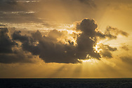 """Rise of the Mayan Sun God,"" Crespuscular Rays (Sunbeams) behind cloud at sunrise over the Caribbean Sea from Cancun, Quintana Roo, Yucatan Peninsula, Mexico"