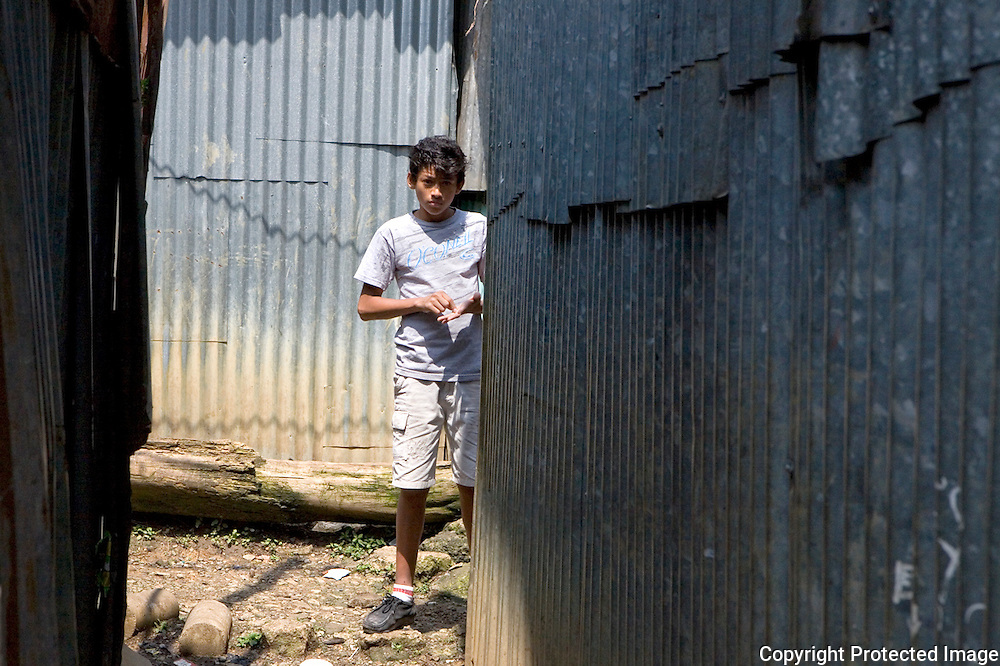 Anthony waiting for his friends in the alley ways between all the shacks in San Felipe.