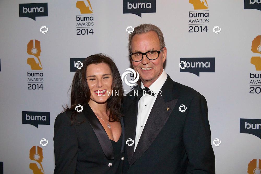 HILVERSUM - Een besloten feest van BUMA AWARDS 2014 in Studio 21 op het Mediapark. Met op de zwarte loper  Tony Berk en zijn partner. FOTO LEVIN DEN BOER - PERSFOTO.NU