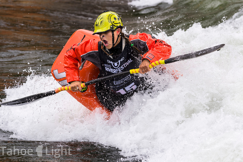 Sage Donnelly of Carson City at Reno Riverfestival 2014 freestyle kayaking. Sage is a world class kayaker despite battling juvenile diabetes and Celiac disease.