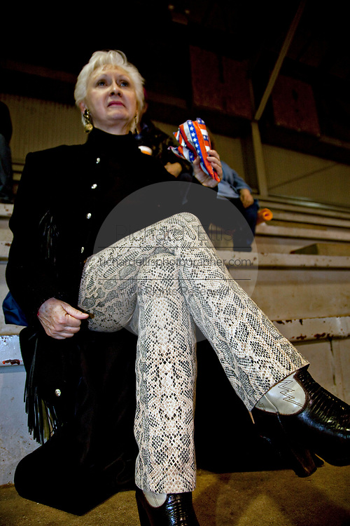 A local resident wearing snake skin pants watches the 51st Annual Sweetwater Texas Rattlesnake Round-Up March 13, 2009 in Sweetwater, Texas. During the three-day event approximately 240,000 pounds of rattlesnake will be collected, milked and served to support charity.