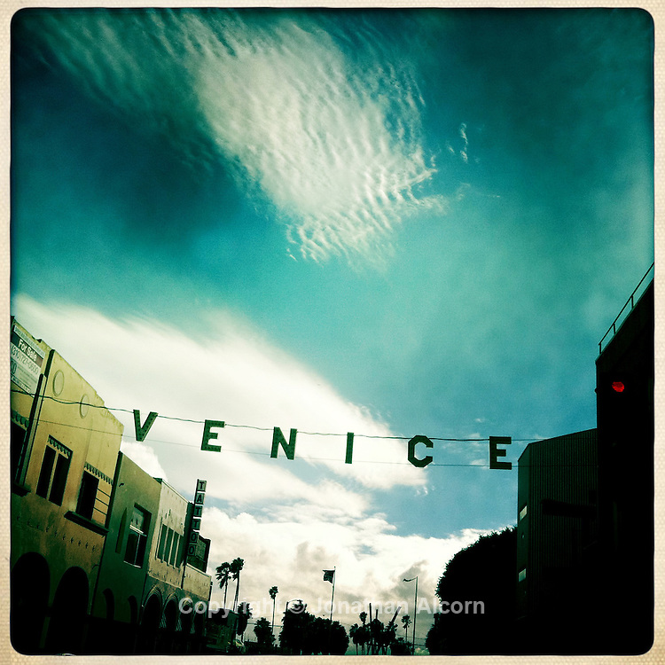 Cloud patterns in the sky behind the Venice Sign at Pacific and Windward