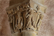 Carved capital with animals carrying the cross, the hand of God, a man meditating and angels pointing to Heaven and earth, in the galleries of the Abbatiale Sainte-Foy de Conques or Abbey-church of Saint-Foy, Conques, Aveyron, Midi-Pyrenees, France, a Romanesque abbey church begun 1050 under abbot Odolric to house the remains of St Foy, a 4th century female martyr. The church is on the pilgrimage route to Santiago da Compostela, and is listed as a historic monument and a UNESCO World Heritage Site. Picture by Manuel Cohen