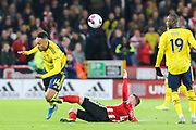 zSheffield United midfielder John Fleck (4) fouls Arsenal forward Pierre-Emerick Aubameyang (14) during the Premier League match between Sheffield United and Arsenal at Bramall Lane, Sheffield, England on 21 October 2019.