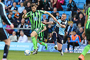 Jon Meades midfielder for AFC Wimbledon (12) and Wycombe Wanderers striker Paul Hayes (captain) (9) battle for the ball during the Sky Bet League 2 match between Wycombe Wanderers and AFC Wimbledon at Adams Park, High Wycombe, England on 2 April 2016. Photo by Stuart Butcher.