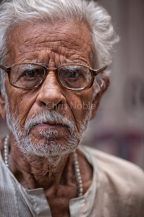 "A portait of a man in the ""galis"" (alley ways) of the Old City of Varanasi India."