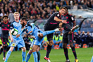 July 13 2017: Arsenal player Krystian Bielik (37) goes up for the ball with Sydney FC forward Alex BROSQUE (captain) (14) at the International soccer match between English Premier League giants Arsenal and A-League premiers Sydney FC at ANZ Stadium in Sydney.