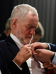 © Licensed to London News Pictures. 09/04/2018. London, UK. Labour Party leader JEREMY CORBYN has help adjusting his tie at the launch event for the Labour Party local election campaign launch in central London.  Labour are expected to make gains in the capital, potentially taking traditionally Conservative strongholds. Photo credit: Ben Cawthra/LNP