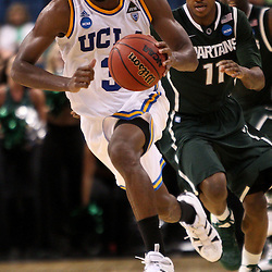 Mar 17, 2011; Tampa, FL, USA; UCLA Bruins guard Malcolm Lee (3) drives past Michigan State Spartans guard Keith Appling (11)  during the second half of the second round of the 2011 NCAA men's basketball tournament at the St. Pete Times Forum. UCLA defeated Michigan State 78-76.  Mandatory Credit: Derick E. Hingle