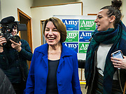 19 JANUARY 2020 - DES MOINES, IOWA: US Senator AMY KLOBUCHAR (D-MN), left, talks to people who came to see her during a campaign event at Urban Dreams in Des Moines. Sen. Klobuchar brought her presidential campaign to Urban Dreams, a community empowerment center in central Des Moines. Iowa hosts the first event of the presidential selection process in February. The Iowa Caucuses are Feb. 3, 2020.          PHOTO BY JACK KURTZ