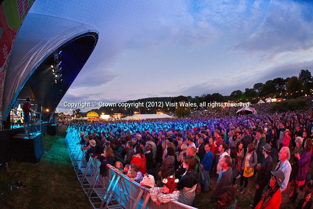 Crowds at main stage at dusk<br /> Green Man Festival 2011<br /> Glanusk Park<br /> Near Crickhowell<br /> Powys<br /> South<br /> Festivals - Music<br /> Events