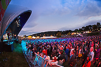 Crowds at main stage at dusk<br /> Green Man Festival 2011<br /> Glanusk Park<br /> Near Crickhowell<br /> Powys<br /> South<br /> Festivals - Music<br /> Events
