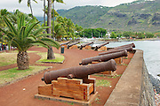 SAINT-DENIS DE LA REUNION, FRANCE - DECEMBER 07, 2010: Old cannons at the sea side of the Saint-Denis De La Reunion, capital of the French overseas region and department of Reunion.