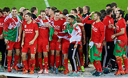 CARDIFF, WALES - Tuesday, October 13, 2015: Wales players celebrate after qualifying for the finals following a 2-0 victory over Andorra during the UEFA Euro 2016 qualifying Group B match at the Cardiff City Stadium. Sam Vokes, Ben Davies, David Edwards, Tom Lawrence, Neil Taylor, Aaron Ramsey. (Pic by Paul Currie/Propaganda)