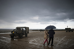 History enthusiasts in uniform tour the beach near the ruins of a military pontoon on the Normandy coast ahead of the 75th D-Day anniversary, in Arromanches, France, 04 June 2019. World leaders are to attend memorial events in Normandy, France on 06 June 2019 to mark the 75th anniversary of the D-Day landings, which marked the beginning of the end of World War II in Europe. Photo by Eliot Blondet/ABACAPRESS.COM