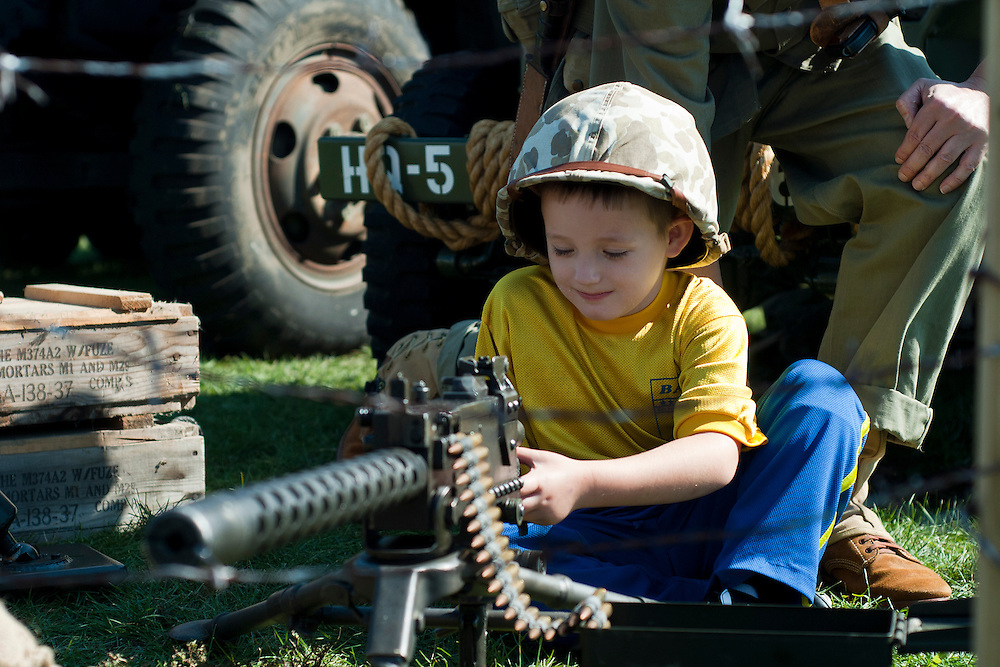 Lathan Goumas | The Bay City Times..Brayden Storm, 5, plays with a Browning 1919 light machine gun during the River of Time at Veterans Park in Bay City, MI., on Saturday September 24, 2011.