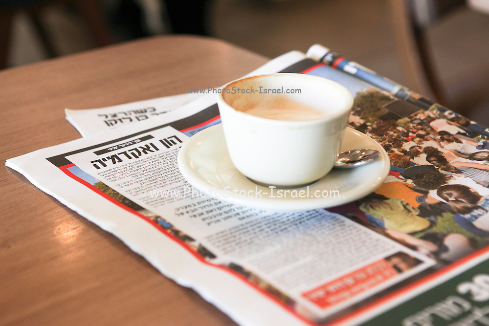 Cup of Coffee and Hebrew morning newspaper