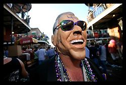 Feb 28th, 2006. New Orleans, Louisiana. Mardi Gras Day, Fat Tuesday, Bourbon Street. General street scenes of the packed and crowded insanity that befalls mainly tourists who come to party on Bourbon street where most locals refuse to go on Fat Tuesday. Scenes of debauchery, costumes, body paint and nakedness abound.