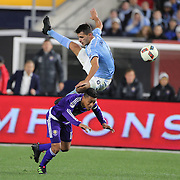 Federico Bravo, NYCFC, goes over the top of Darwin Ceren, Orlando, as they challenge for the ball during the New York City FC Vs Orlando City, MSL regular season football match at Yankee Stadium, The Bronx, New York,  USA. 18th March 2016. Photo Tim Clayton