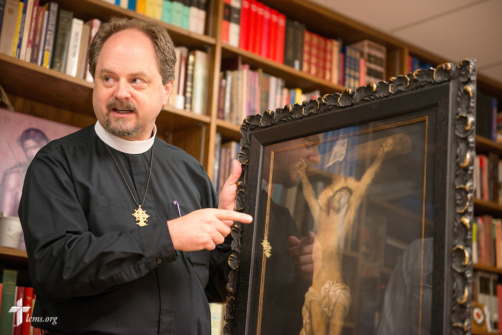 The Rev. Dr. Daniel Harmelink, executive director of Concordia Historical Institute (CHI), discusses a piece of work in his office on Monday, July 21, 2014, on the campus of Concordia Seminary in Clayton, Mo.  LCMS Communications/Erik M. Lunsford