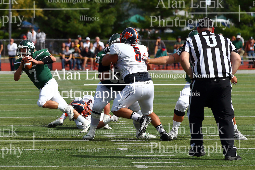 01 October 2016:  Mike Mulcrone holds off Noah Spielman so Brandon Bauer can continue his run during an NCAA division 3 football game between the Wheaton Thunder and the Illinois Wesleyan Titans in Tucci Stadium on Wilder Field, Bloomington IL (Photo by Alan Look)