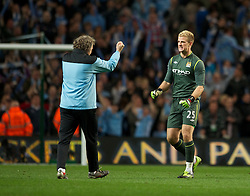 MANCHESTER, ENGLAND - Monday, April 30, 2012: Manchester City's goalkeeper Joe Hart celebares at full-time with a member of the coaching staff following the Premiership match at the City of Manchester Stadium. (Pic by Chris Brunskill/Propaganda)