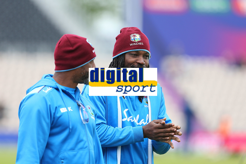 Cricket - 2019 ICC Cricket World Cup - Group Stage: South Africa vs. West Indies<br /> <br /> Chris Gayle of the West Indies chats to head coach Floyd Reifer during the pre match warm up at the Hampshire Bowl, Southampton.<br /> <br /> COLORSPORT/SHAUN BOGGUST