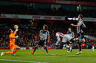 Danny Welbeck of Arsenal (2nd right) beats Jak Alnwick of Newcastle United but the effort is ruled out for a foul during the Barclays Premier League match at the Emirates Stadium, London<br /> Picture by David Horn/Focus Images Ltd +44 7545 970036<br /> 13/12/2014