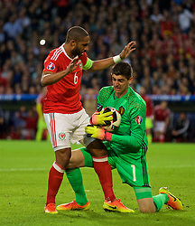 LILLE, FRANCE - Friday, July 1, 2016: Wales' captain Ashley Williams and Belgium's Thibaut Courtois during the UEFA Euro 2016 Championship Quarter-Final match at the Stade Pierre Mauroy. (Pic by David Rawcliffe/Propaganda)