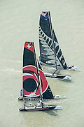 Alinghi and Emirates Team New Zealand, Day four of the Extreme Sailing Series regatta being sailed in Singapore. 23/2/2014