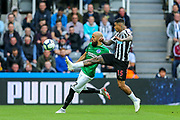 Kenedy (#15) of Newcastle United attempts to block a clearance from Bruno Saltor (#2) of Brighton & Hove Albion during the Premier League match between Newcastle United and Brighton and Hove Albion at St. James's Park, Newcastle, England on 20 October 2018.