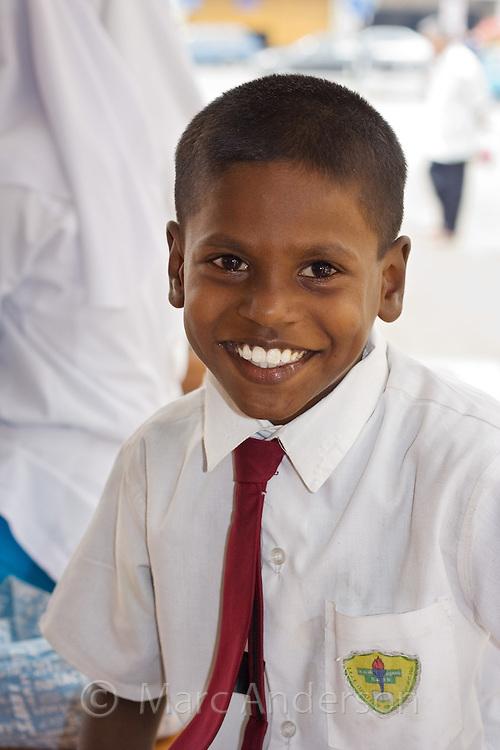 An Indian boy in school uniform smiling, Malaysia