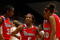March 21, 2011; Stanford, CA, USA; St. John's Red Storm guard Nadirah McKenith (5) huddles with her team after committing a foul against the Stanford Cardinal during the second half of the second round of the 2011 NCAA women's basketball tournament at Maples Pavilion. Stanford defeated St. John's 75-49.