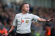Match ref David Webb issues discipline during The FA Cup match between Burton Albion and Peterborough United at the Pirelli Stadium, Burton upon Trent, England on 7 November 2015. Photo by Aaron Lupton.