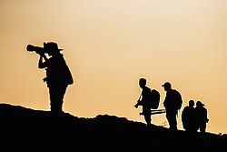 Silhouette of photographers in the Galapagos, Santiago Island, Galapagos Islands, Ecuador
