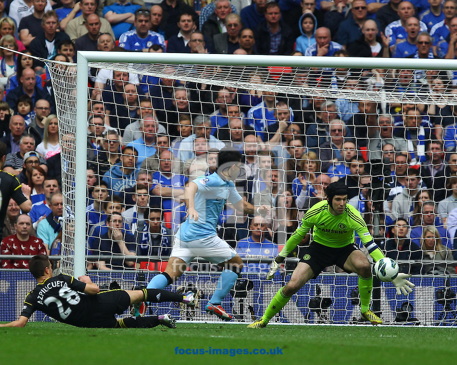 Picture by John Rainford/Focus Images Ltd +44 7506 538356.14/04/2013.Petr Cach of Chelsea saves from Sergio Aguero of Manchester City during the FA Cup semi final match at Wembley Stadium, London.