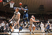 WEST LAFAYETTE, IN - JANUARY 24: Tim Hardaway Jr. #10 of the Michigan Wolverines drives to the basket against Robbie Hummel #4 and Ryne Smith #24 of the Purdue Boilermakers at Mackey Arena on January 24, 2012 in West Lafayette, Indiana. Michigan defeated Purdue 66-64. (Photo by Joe Robbins/Getty Images) *** Local Caption *** Tim Hardaway Jr.;Robbie Hummel;Ryne Smith