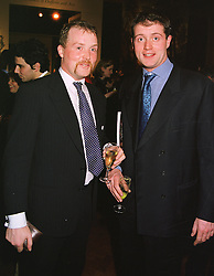 Left to right, the EARL OF IVEAGH and his brother the HON.RORY GUINNESS, at a reception in London on 22nd March 1999.MPO 32