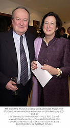 MR RICHARD ANELAY and his wife BARONESS ANELAY OF ST.JOHNS, at an exhibition in London on 28th February 2001.OLR 41