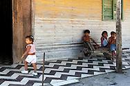 Children on a porch in Campechuela, Granma, Cuba.