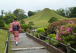 Woman in kimono walking in SuizenJi Garden in Kumamoto, Kumamoto prefecture, Kyushu, Japan