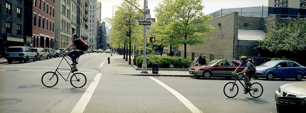 With space at a premium in the vast metropolis of Manhattan, New York City, locals find ways and means for pastime exercise and recreational activities as they go about their daily lives..A bike with a viewÖCyclists in Greenwich Village on May 4, 2004. Photo Tim Clayton.
