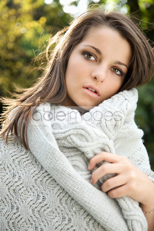 Close up of a young woman wrapped in a blanket