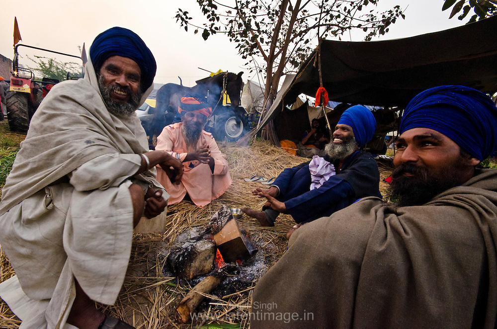 A group of Nihang in front of fire early in the morning during Hola Mohalla